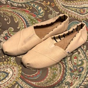 Toms tan slip on shoes